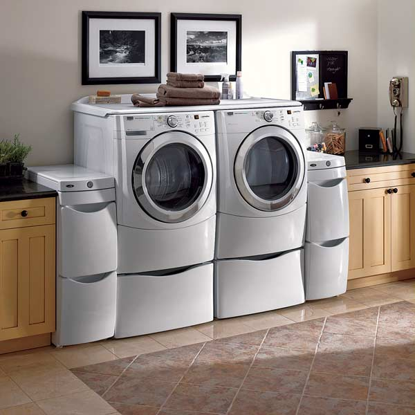Users short and tall can sit to access front-load washers and dryers. Multilevel drawers increase the unit's functionality. Photo: Maytag