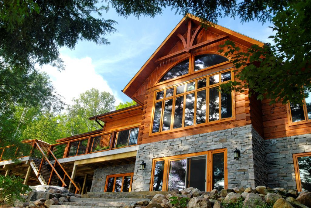 Lake of bays log home floor plans by 1867 confederation for Timber frame hybrid house plans