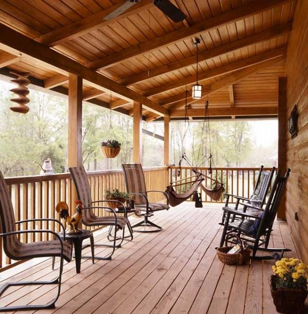 Photos of a south carolina log home coming home again for Log cabin porches and decks