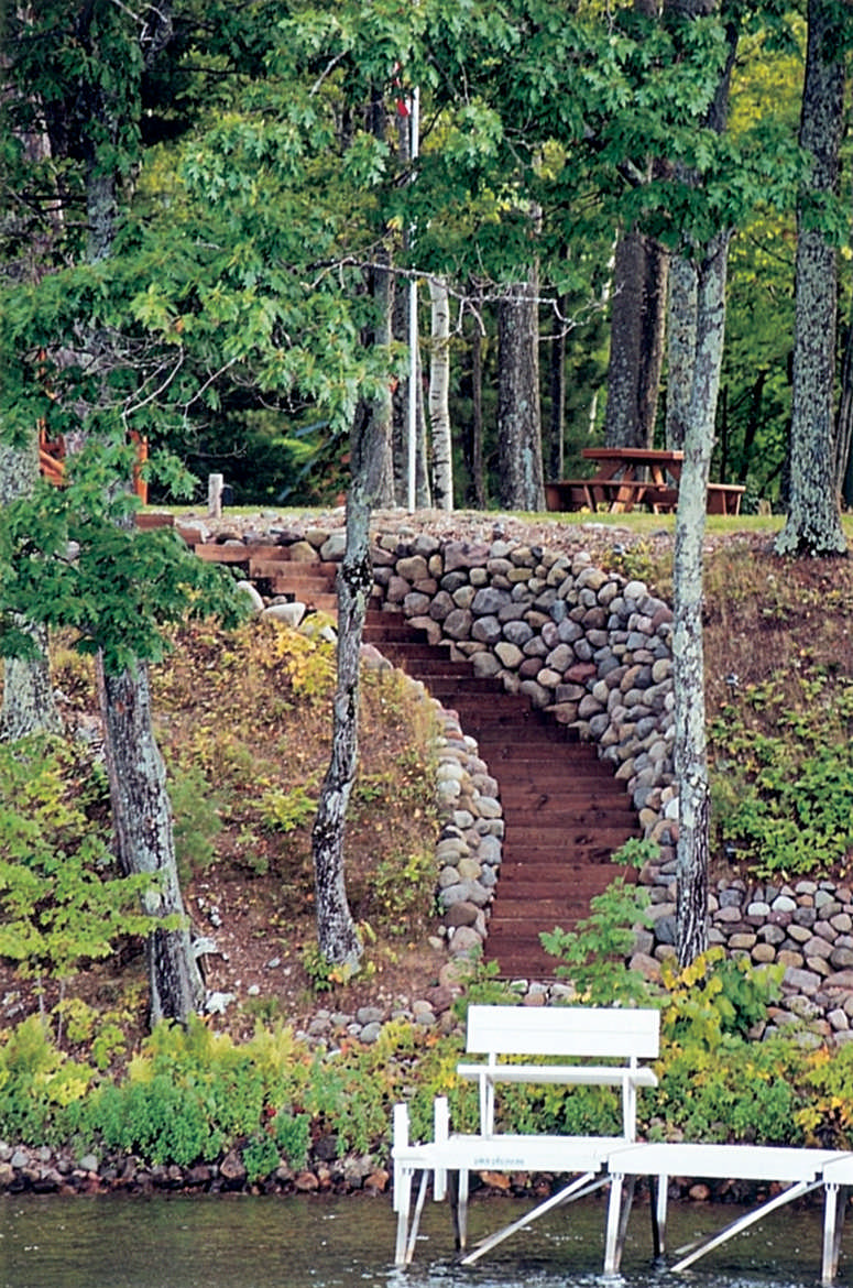 Excavated stairs can work on gentle to medium slopes a better solution that minimize erosion and run off is elevated stairs with a vegetative cover cabin