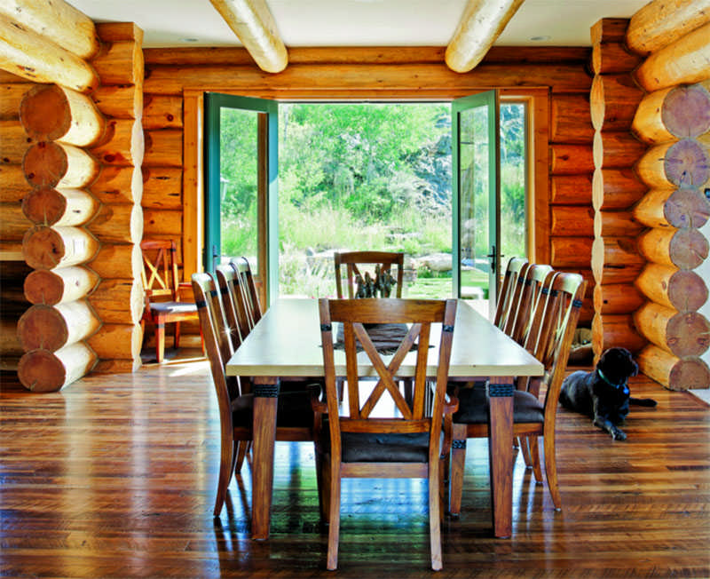 log home dining room open doors