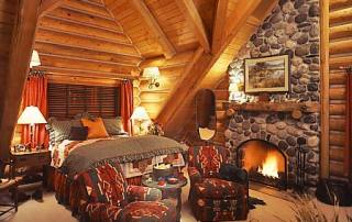 roaring-fire-in-log-home-bedroom