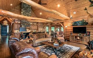 Living-Room-Great-Unique-Tie-Beams-Wood-Flooring-Interior-Dowell-Golden-Eagle-Log-Homes-11