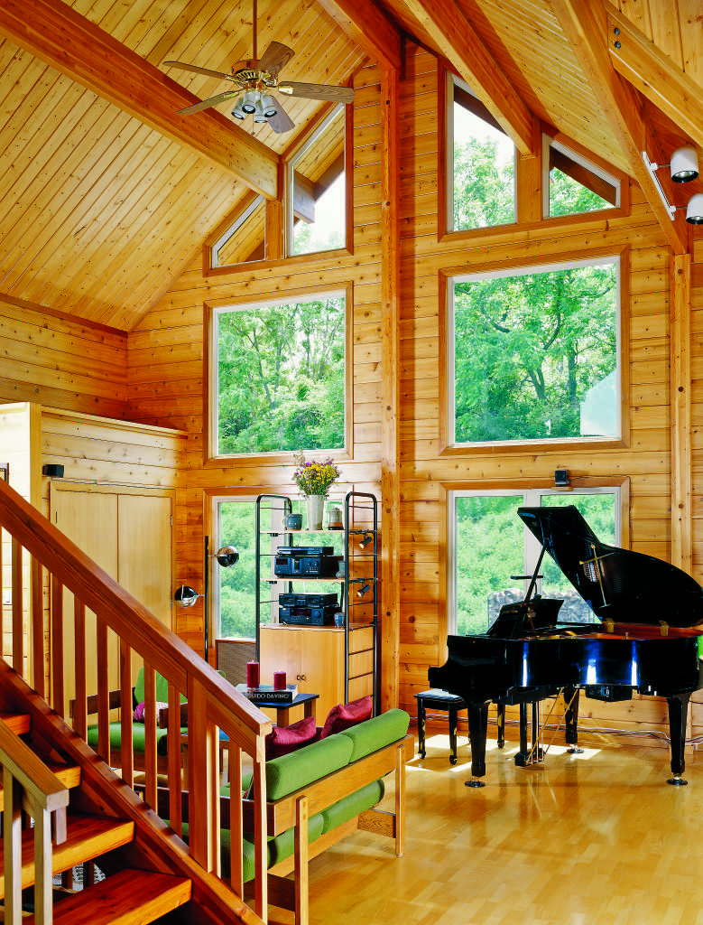 A log home vaulted ceiling is a dramatic but sometimes impractical feature.