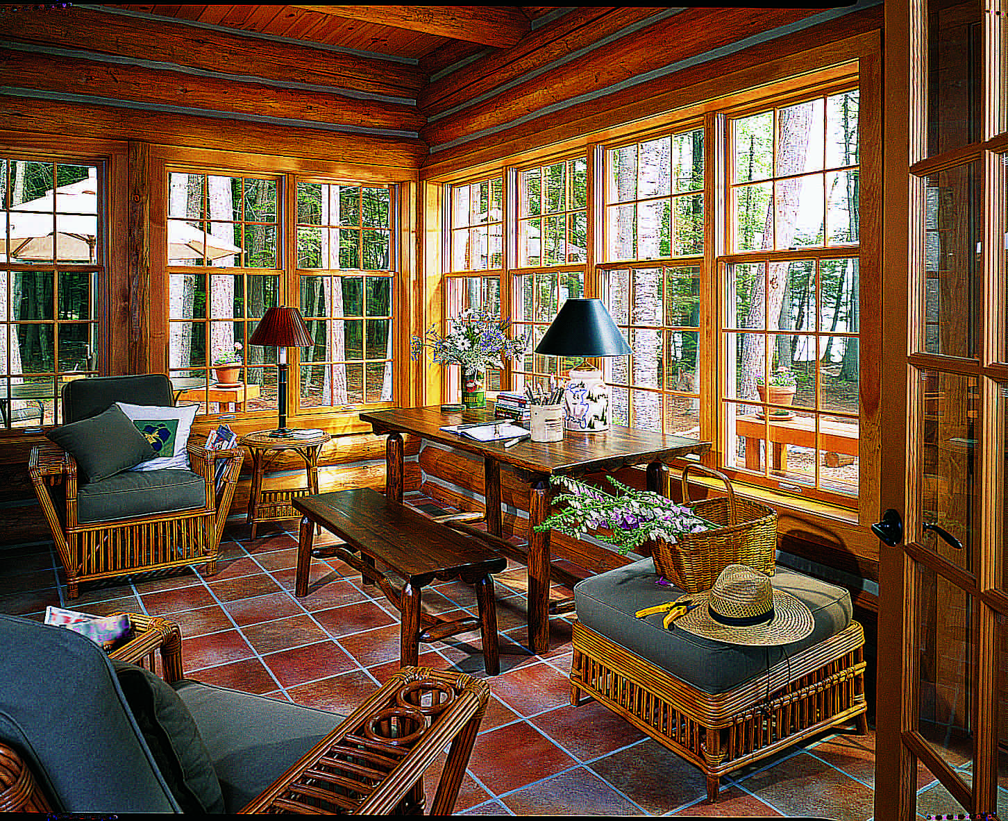 Sitting pretty log home decks and porches for Log home sunrooms