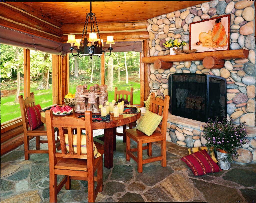 dining area log home sunroom