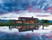 Sky and mountains as far as the eye can see are the only things in sight at this Montana retreat.