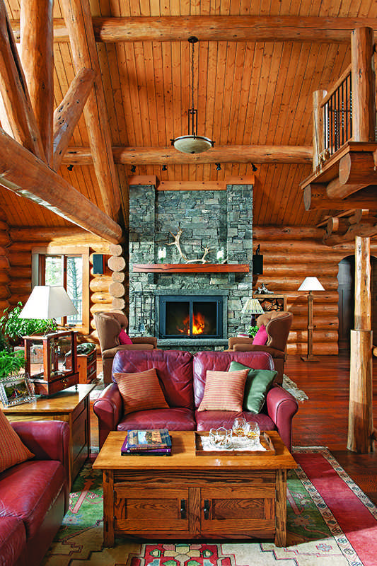 Montana log home interior great room stone fireplace