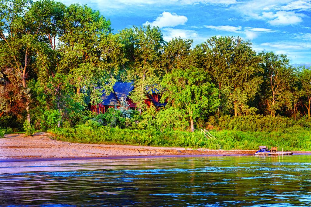 waterfront log home riverside
