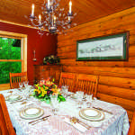 waterfront log home dining room