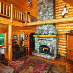 waterfront log home fireplace