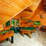 waterfront log home game room