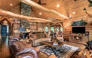Living-Room-Great-Unique-Tie-Beams-Wood-Flooring-Interior-Dowell-(Golden-Eagle-Log-Homes)-11
