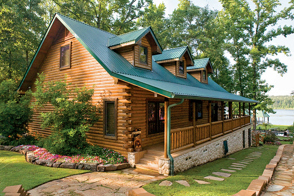 A custom crafted log home lives large log home living for Big log homes