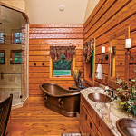 "An en suite bath, with walk-in shower, soaking tub and dual sinks, gets the copper treatment, giving the room a warm vibe. ""The tub really holds the heat and is a great place watch the snow fall,"" Mike says."