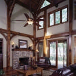 timber-frame-home-great-room-with-posts-and-beams-stone-fireplace-540x627