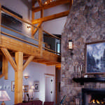 Post-and-beam-great-room-with-stone-firplace-and-wood-mantel