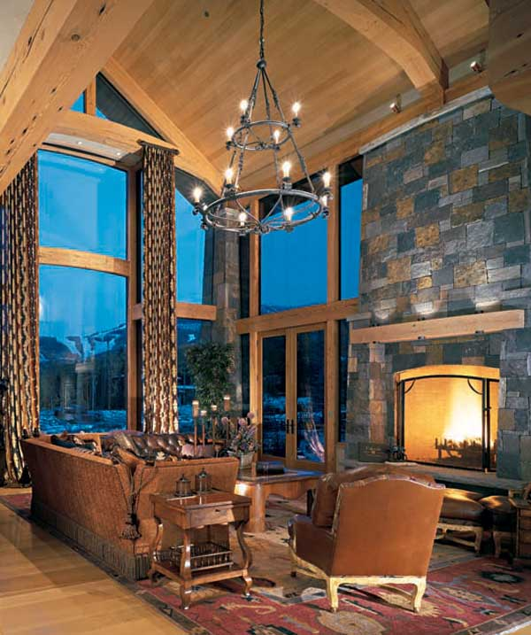 mantel lighting. timberframe home cathedral ceiling great room stone fireplace wooden mantel lighting s