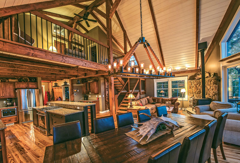 Surprising Timber Frame Home Great Room With Posts And Beams Stone Fireplace Largest Home Design Picture Inspirations Pitcheantrous