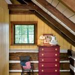 At the top of the stairs, exposed 2-by-4 rafters maintain their rough-cut patina. Each has a collar beam across it. The Donelsons chose to paint some of the wood to lighten up the space.