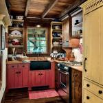 A rustic farmhouse kitchen with modern undertones is timeless. David T. Smith custom-made the open shelves, curly maple upper cabinets and furniture-style cabinetry that covers the refrigerator and dishwasher. Throughout the cabin, the floor is pegged 2-inch thick poplar planks.