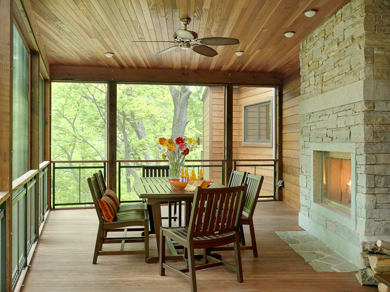Design ideas for cabin decks and porches for Four season rooms with fireplaces